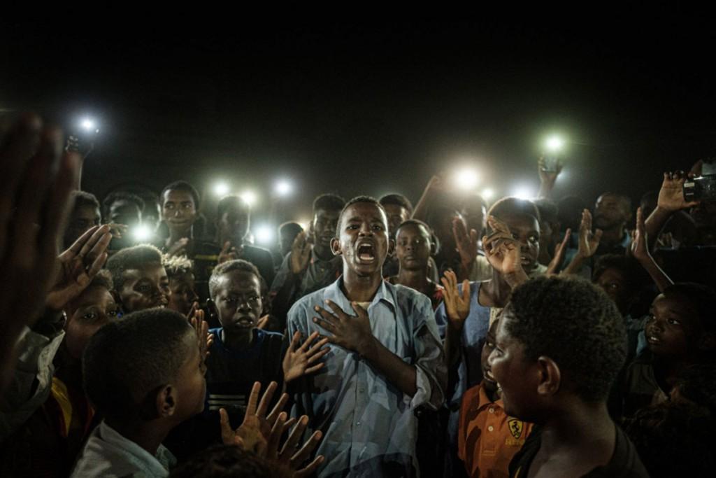Yasuyoshi Chiba. معترضان سودانی، خارطوم، 19 ژوئن 2019. عکس برنده جایزه ورلد پرس فتو 2020