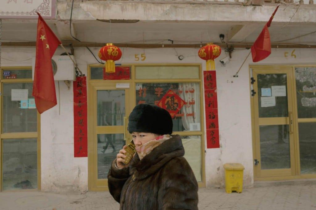 پاتریک وک. زن اویغور در خیابانی در شهر باستانی قەشقەر، استان سینکیانگ، 31 ژانویه 2019