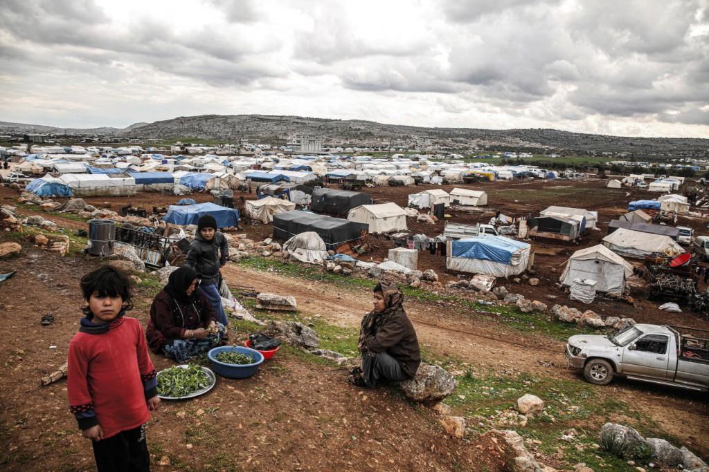 Mohamad Zayat برای UNOCHA. «زنان در حال تدارک غذا در کمپ IDP، ادلب»، مارس 2020
